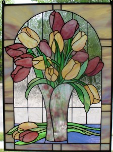 Feeling like Spring?  A beautiful vase of pink and yellow of Tulips makes us smile!
