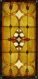 This stained glass panel of opalescent glass has been installed to cover flourescent lights.